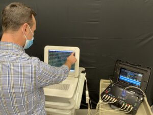 demoing a ultrasound machine with a biomedical services personnel